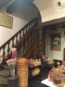 Look at this chocolate shop situated on the bottom level of a medieval building!