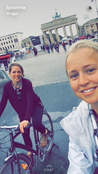 We almost crashed into horses while trying to pull off this bike-selfie with Brandenburg Gate in the background. :)