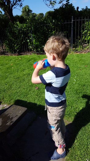 Mr Toddler taking refreshment in the park from his Smiggle silicon roll bottle.