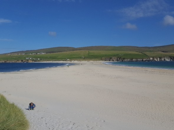Playing on the beach at St Ninian's Isle