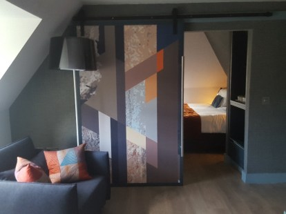 View into the bedroom of the Pinnacle Suite