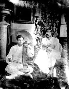 Rabindranath (right) singing with Abanindranath Tagore.  Image credit: Ministry of Culture, Government of India