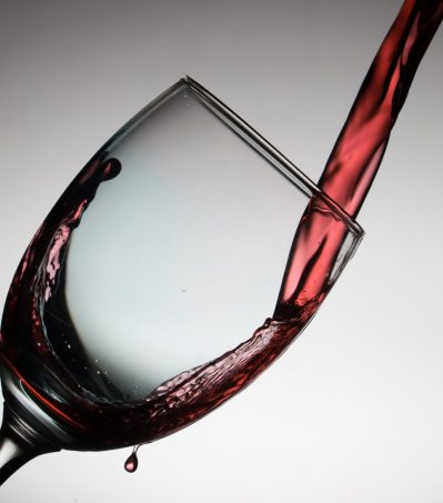 Wine poured into glass for Wildfire: wine country mystery #1