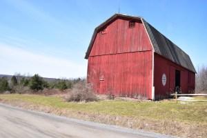 Red barn against a blue sky on Fox Hill Rd