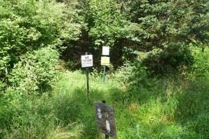 Signs at trailhead on Irish Hill Rd, trail heading west