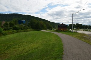 Sign along walkway next to NY 417 in both English and Iroquois; Casino on the left