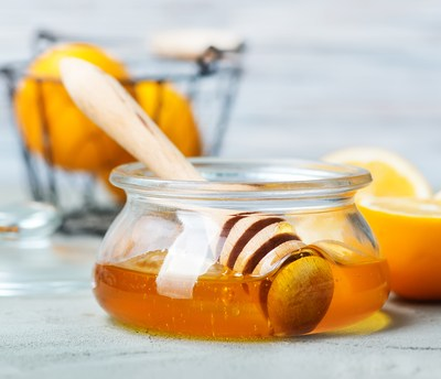 Natural Remedies to get rid of a sore throat, including Ginger Tea and Honey Toddy.