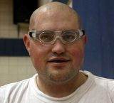 Picture of Scott with protective basketball goggles and a mouthguard