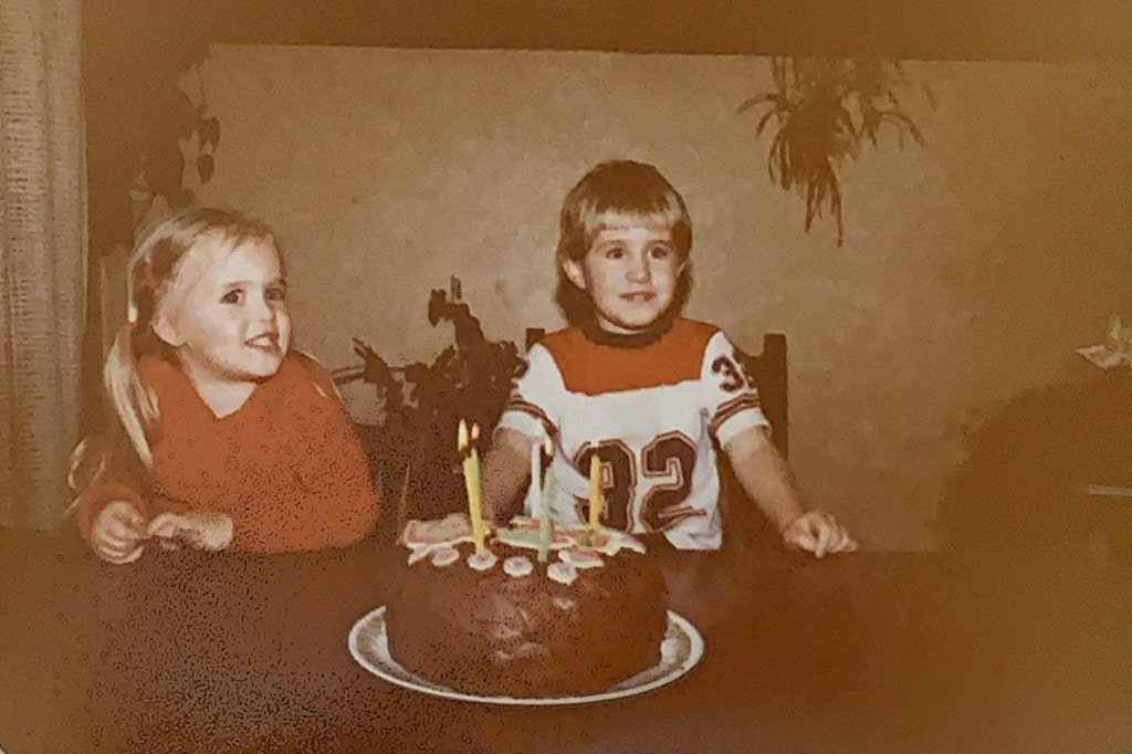 Me and my sister with my fifth birthday cake