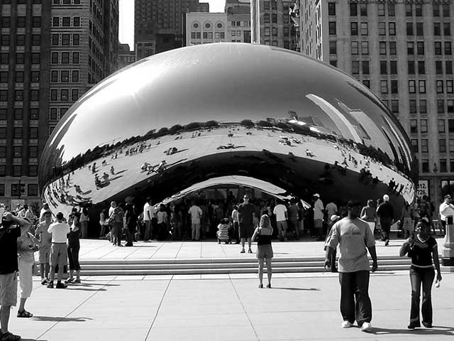 Black and white photograph of the Cloud Gate in Millenium Park, Chicago, Illinois