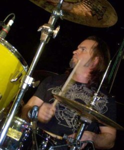 candid shot of Scott Byler drumming