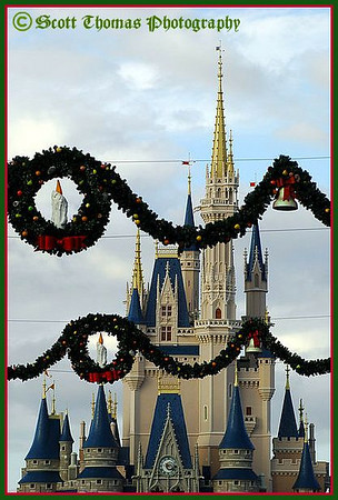 Christmas wreaths on Main Street USA in front of Cinderella Castle in the Magic Kingdom, Walt Disney World, Orlando, Florida.