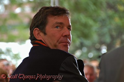 Dennis Quaid, who plays Coach Ben Schwartzwalder in the movie, The Express, looks back at the Ernie Davis statue while addressing the audience.