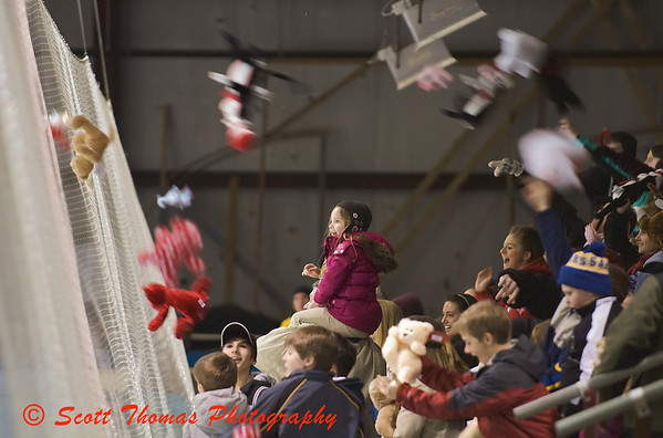 Teddy Bears fly over spectators heads during the first intermission of the Baldwinsville Varsity Boys Ice Hockey game against Oswego on Thursday, January 29, 2009.  All Teddy Bears were collected to be given to Crouse Hospital.