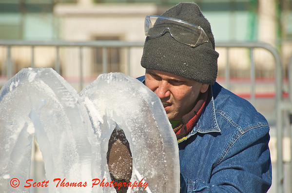 Adam Vural concentrates on getting his ice sculpture just right.
