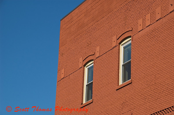 A renovated red brick building sets off the brilliant blue sky of late winter.