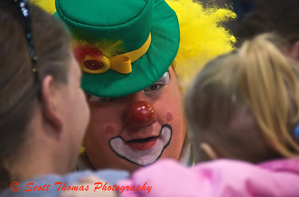A Clown makes a friend at the Tigris Shrine Circus at the NYS Fairgrounds Coliseum near Syracuse, New York on Sunday, April 5, 2009.