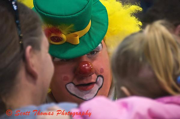 A Clown makes a friend at the Tigris Shrine Circus at the NYS Fairgrounds Coliseum near Syracuse, New York on Sunday, April 5, 2009.