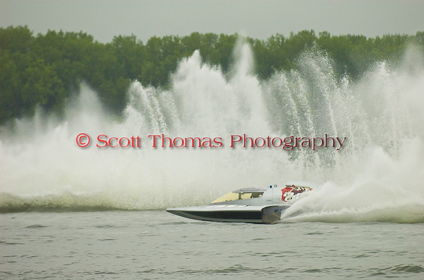 Miss Dinomytes (GP46) driven by Pierre Maheu from Quebec, Canada, chases down the leader durng a Grand Prix Hyrdroplane heat during the Syracuse Hydrofest on Saturday, June 20. 2009.