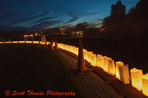 Lighted luminaries line the inside of the Pelcher-Arcaro Staduim at the Baldwinsville, New York, Relay for Life Cancer fund raiser held on Friday, June 19, 2009.