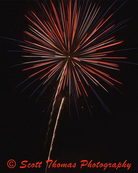 A patriotic firework burst over Paper Mill Island in Baldwinsville, New York, in celebration of the July 4th holiday.