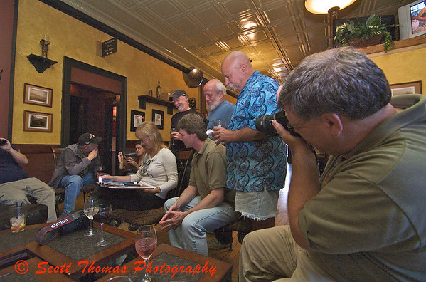 Members of the Syracuse Photographers Association check out a members portfolio at the Mohegan Manor in Baldwinsville, New York.