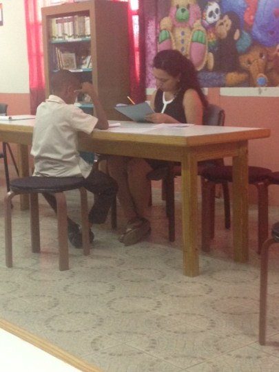 A Peace Corps Trainee conducts the ECBLA with a student from Desruisseaux Combined School