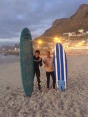 Kevin Wang and Don Nguyen prepare to take to the water for some sunrise surfing.