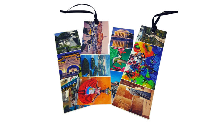 Bookmarks made, using the border pictures of an old travel calendar, a laminating sheet, and black ribbon