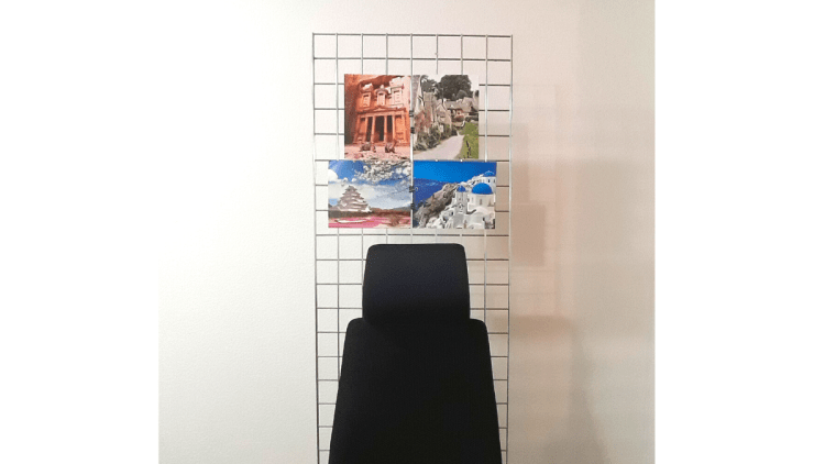 A standing grid screen decorated with pictures from an old travel calendar