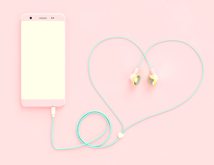 Mobile phone with ear buds and wiring configured in a heart shape