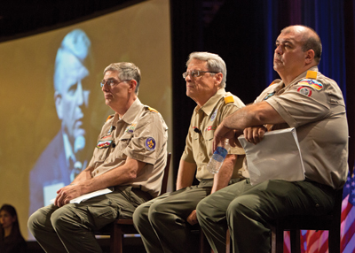The Key 3—National President Wayne Perry, Chief Scout Executive Wayne Brock, and National Commissioner Tico Perez—listen during a pre-vote information session as voting members of the BSA vocalize their opinions regarding the proposed membership-policy resolution.