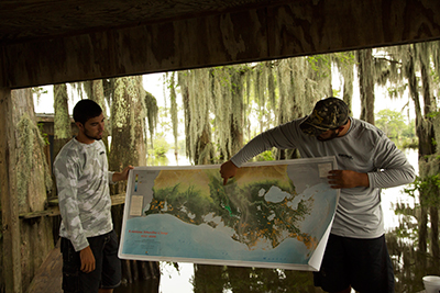 Staffers René Guilbeaux and Derek Breaux explain the area's ecosystem.