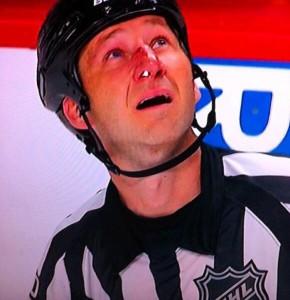 NHL Referee Steve Kozari (#40) hit up high at Coyotes/Blues on January 30, 2014