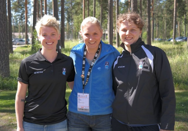 Olympic gold medal game ref and new referee instructor Joy Johnston (middle) with two of the aspiring game officials at the 2014 IIHF Hockey Development Camp, Ainslie Gardner from Australia (L) and Jessica Brambilla from Italy (R). (Photo: Martin Merk/IIHF.com)