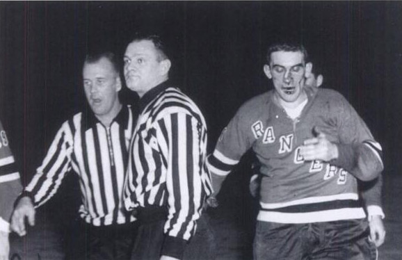 Referee Frank Udvari works a memorable game between the New York Rangers and the Detroit Red Wings