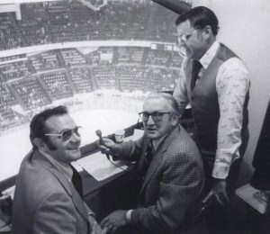 (Photo: Collection of Robert L. Wimmer.) Red wings broadcasters Sid Abel (C) and Bruce Martyn (R) interview referee Frank Udvari between periods from their booth in Olympia Stadium. From Detroit's Sports Broadcasters: On teh Air by George B Eichorn