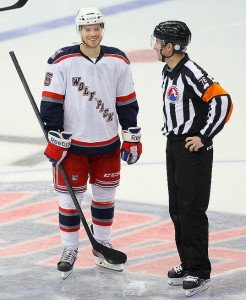 Referee Kendrick Nicholson talks with Oscar Lindberg of the Hartford Wolf Pack