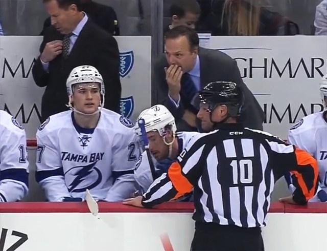 Referee Paul Devorski addresses the Lightning bench after Leggo leaves the ice