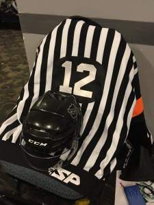 WCHA Referee Butch Mousseaux