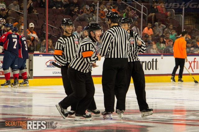 Officials Lucas Martin, Terrence Murphy, Riley Bowles, and Nick Briganti gather at center ice prior to the opening face-off of the 2016 All-American Prospects Game