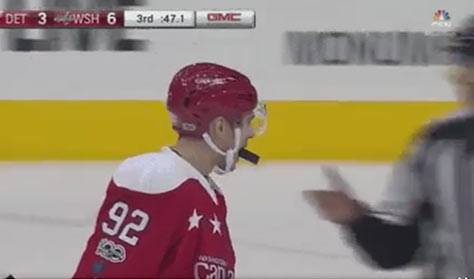 Caps' Kuznetsov Gives Puck to Linesman With His Mouth