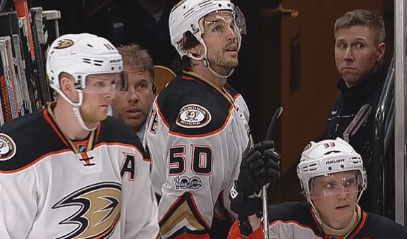 Anaheim's Antoine Vermette watches the replay of his slash on linesman Shandor Alphonso
