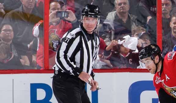 Linesman Brad Kovachik Catches Puck Off Glass