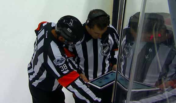 Referees Francois St. Laurent and Chris Rooney review the Anaheim Ducks' Game-Tying Goal in Game 5 against the Edmonton Oilers