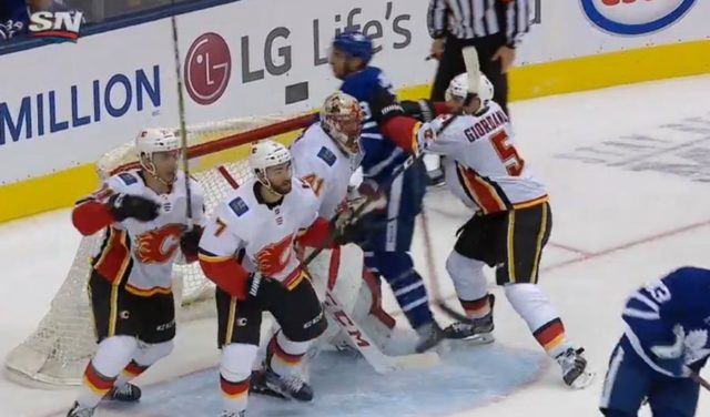 Calgary's Mark Giordano picks up an interference penalty late in the third period of Monday night's game between the Flames and Toronto Maple Leafs