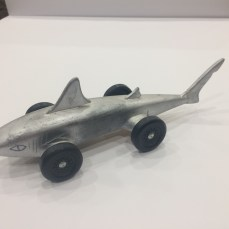silver shark with wheels at the end of the pectoral and pelvic fins. Hand carved dorsal and caudal fins