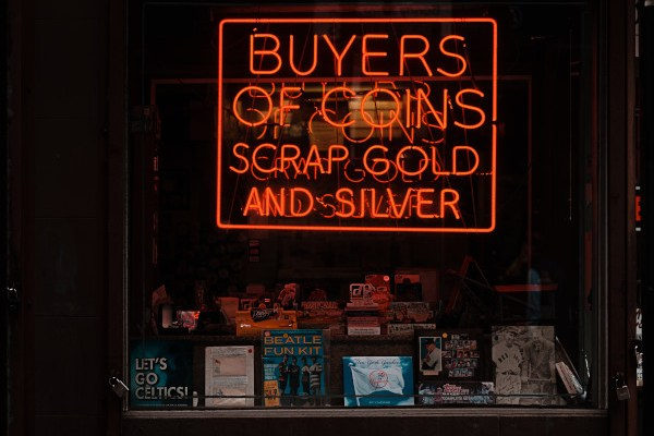 Neon sign in a pawn shop window