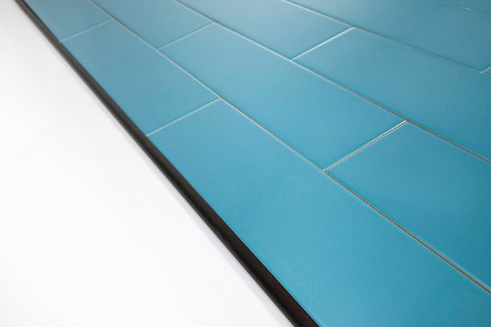 5th Avenue Turquoise Subway Tile With Schluter Black Rondec