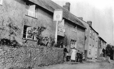 Family outside the King Arms Inn, c1920